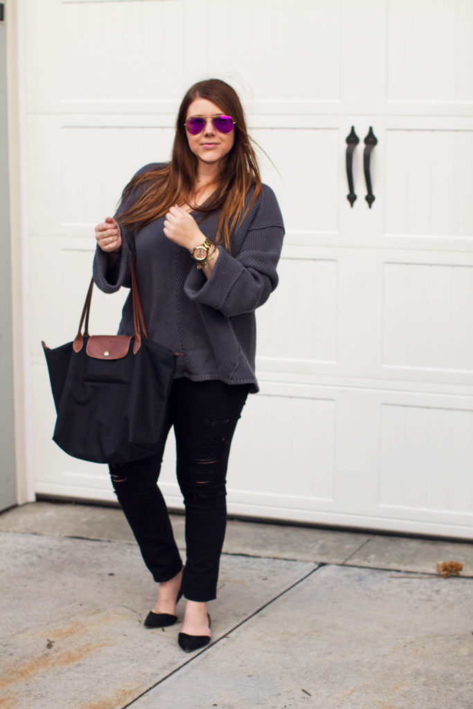 Full outfit view of blue bell sleeved OTS sweater with pink ray bans, ripped jeans and black pointy flats by Margaret Paige